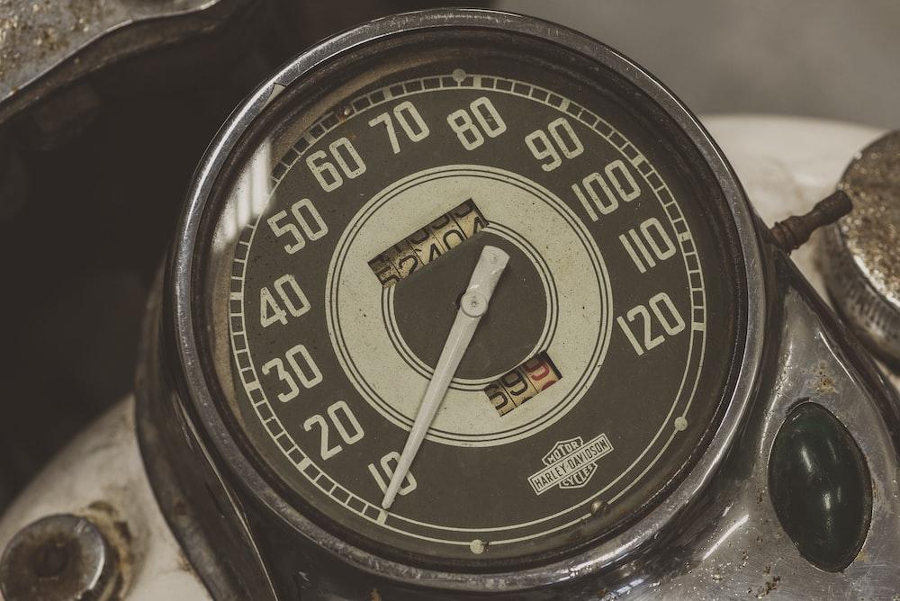 black and white analog gauge displaying 10