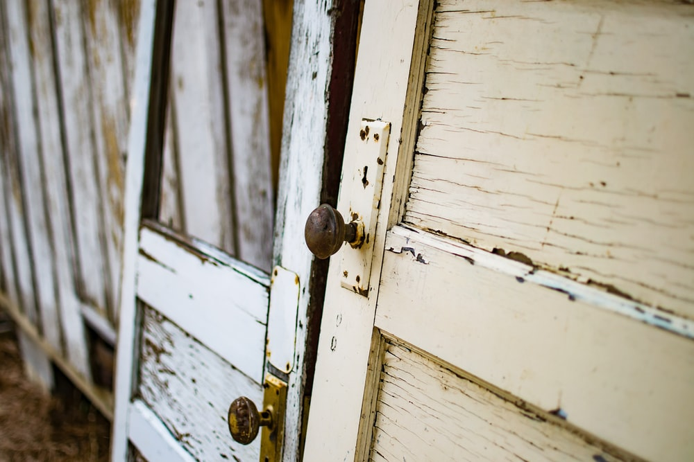 two wooden doors on fences