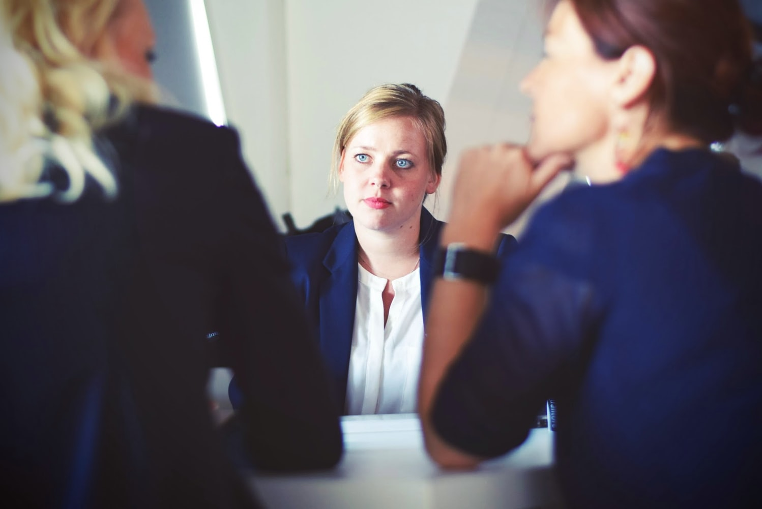 woman looking concerned in a business meeting
