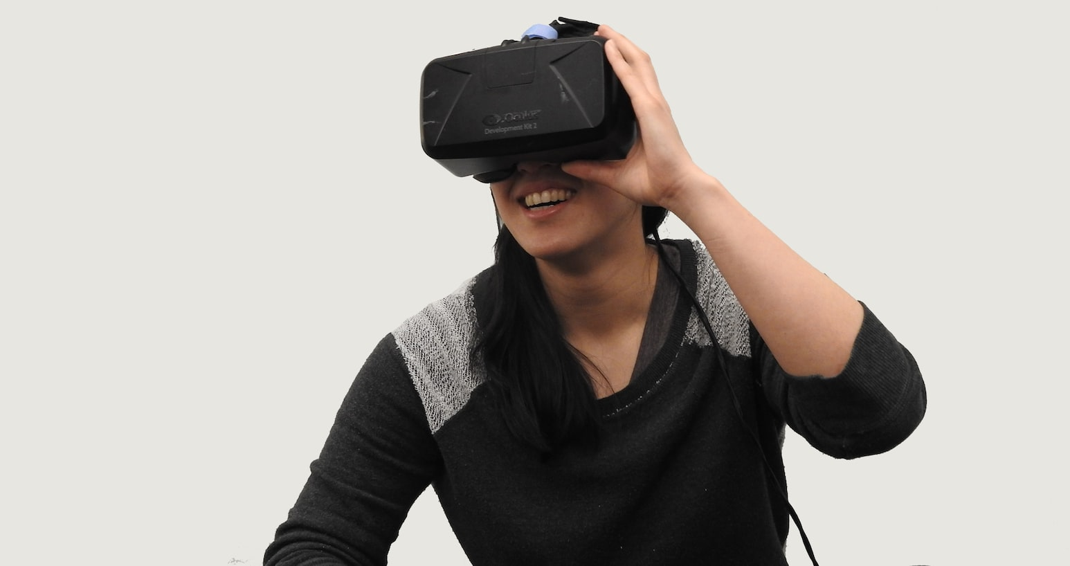 woman in black sweater using oculus vr