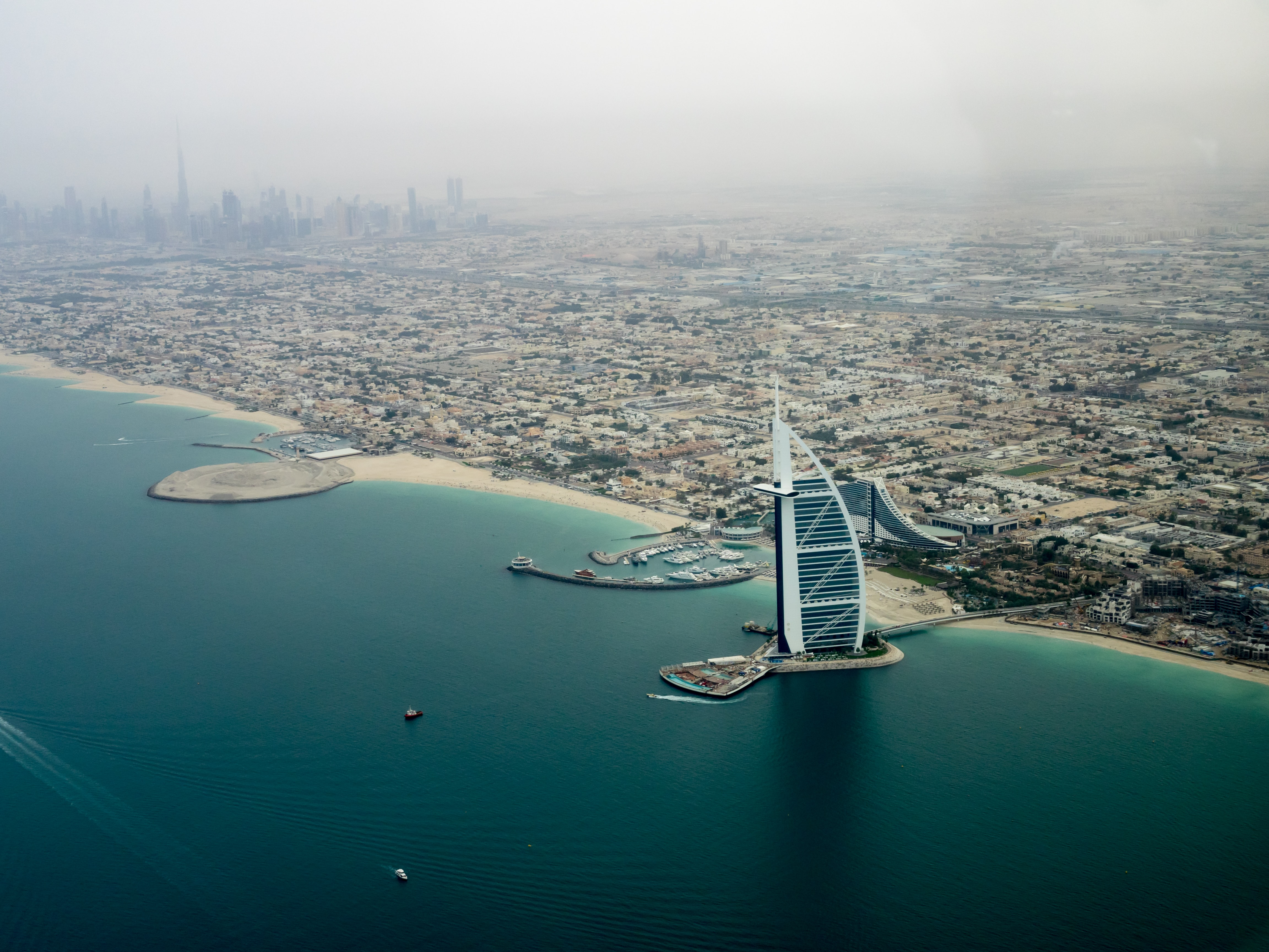 Drone shot of the marina in Dubai with the tall Burj Al Arab hotel