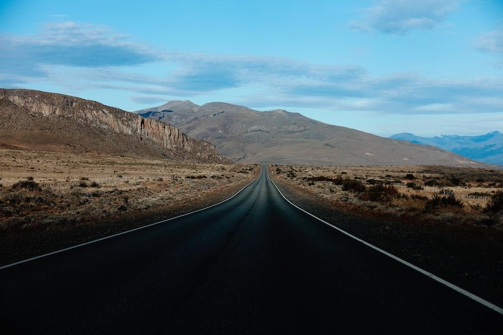 road in the desert during daytime