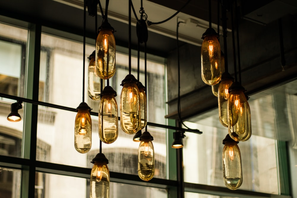 black pendant lamps with beige glass bulbs