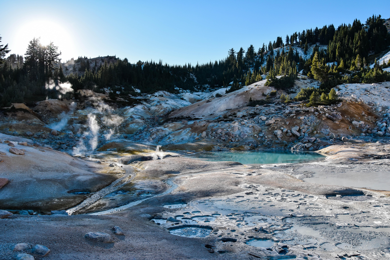 Vapor over melting ice on volcanic rocks