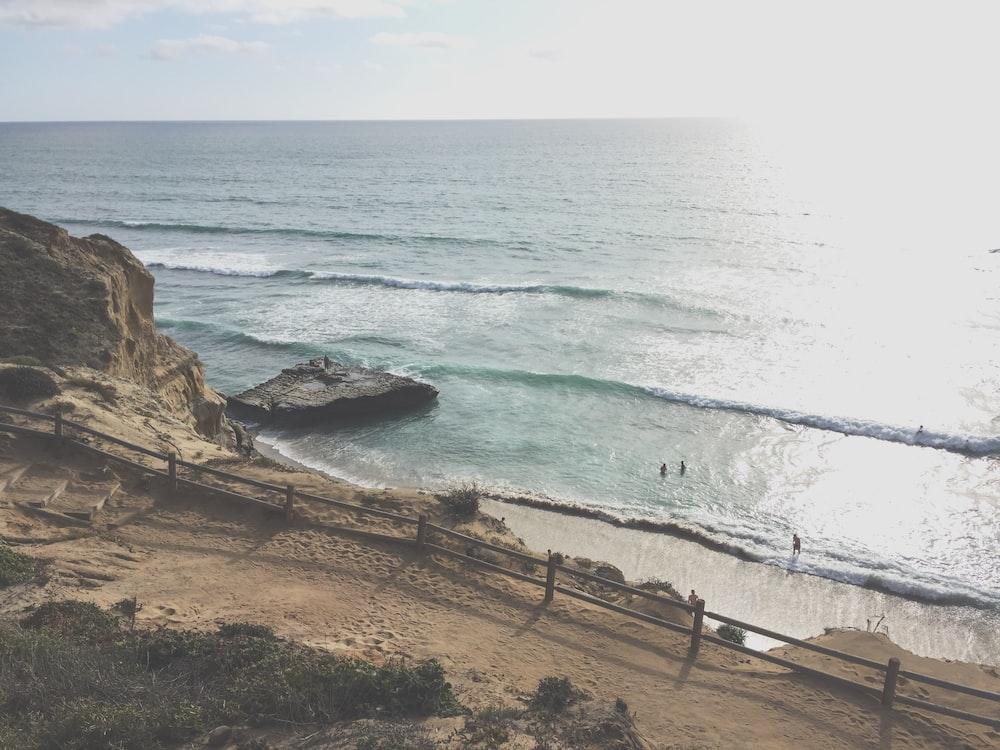 sea waves near rock formation