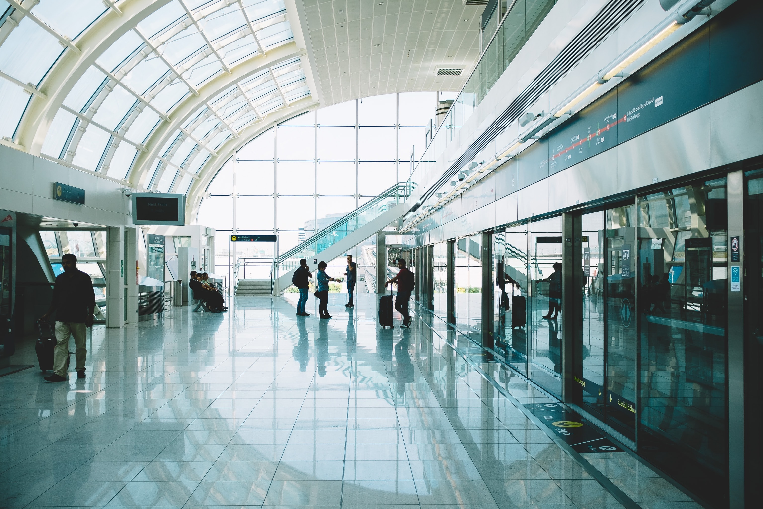 People on a glossy floor in an airport in Dubai
