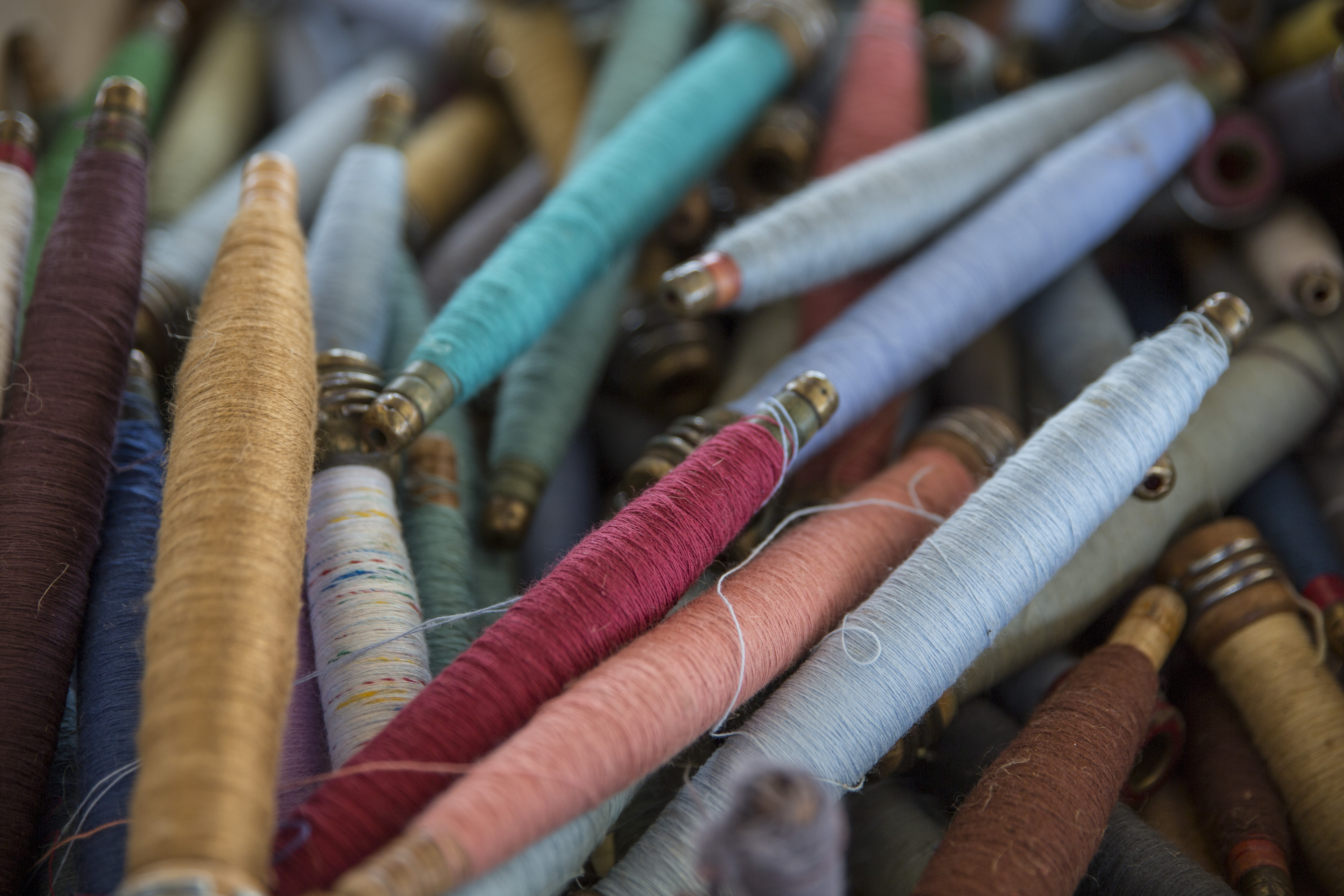 Pile of multicolored craft threads and spools close up in Springfield