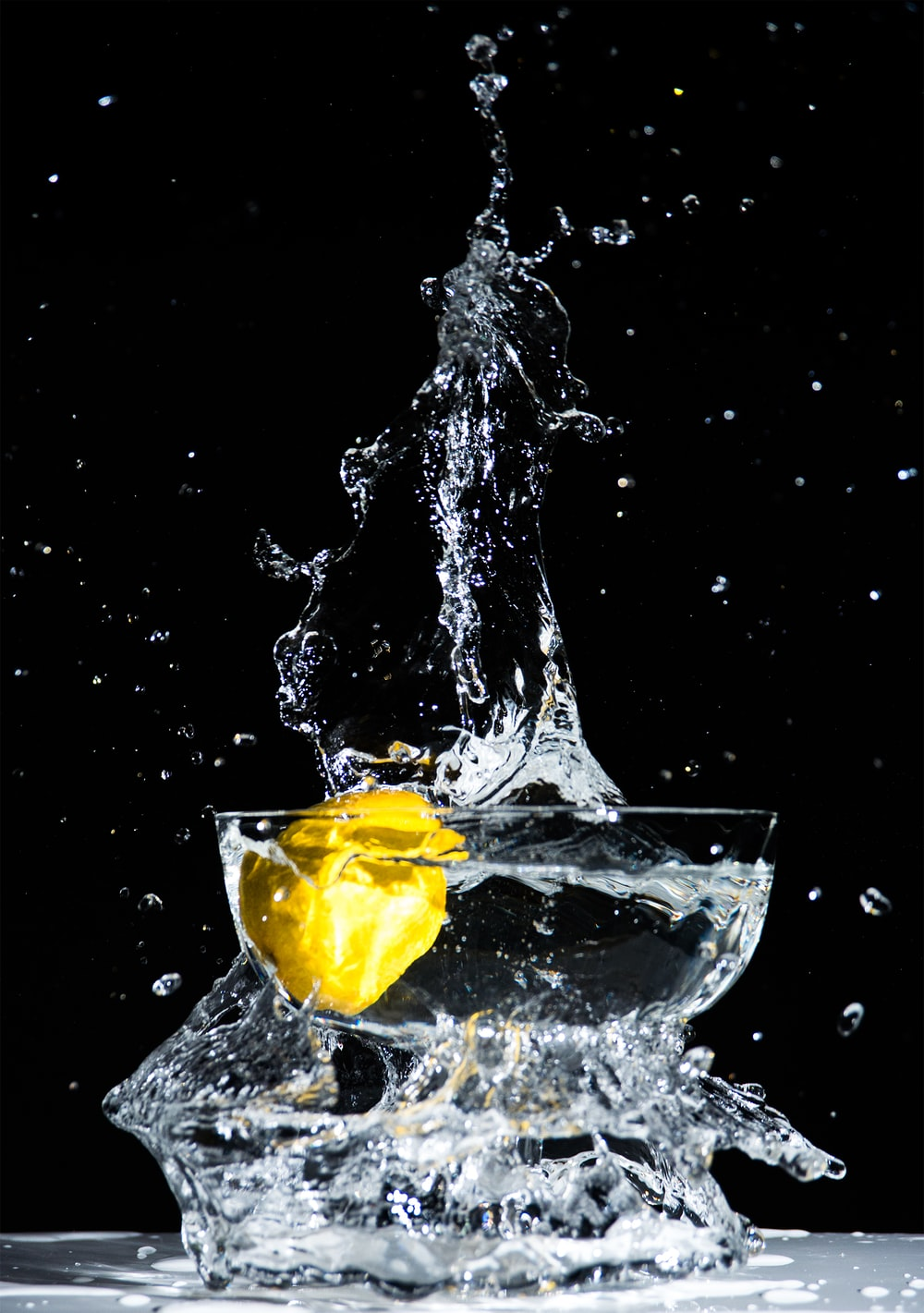 lemon water in footed glass