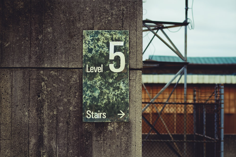 brown level 5 signage
