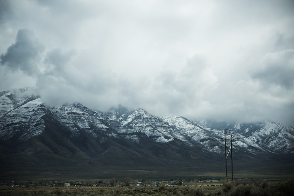 gray mountain with cloudy sky