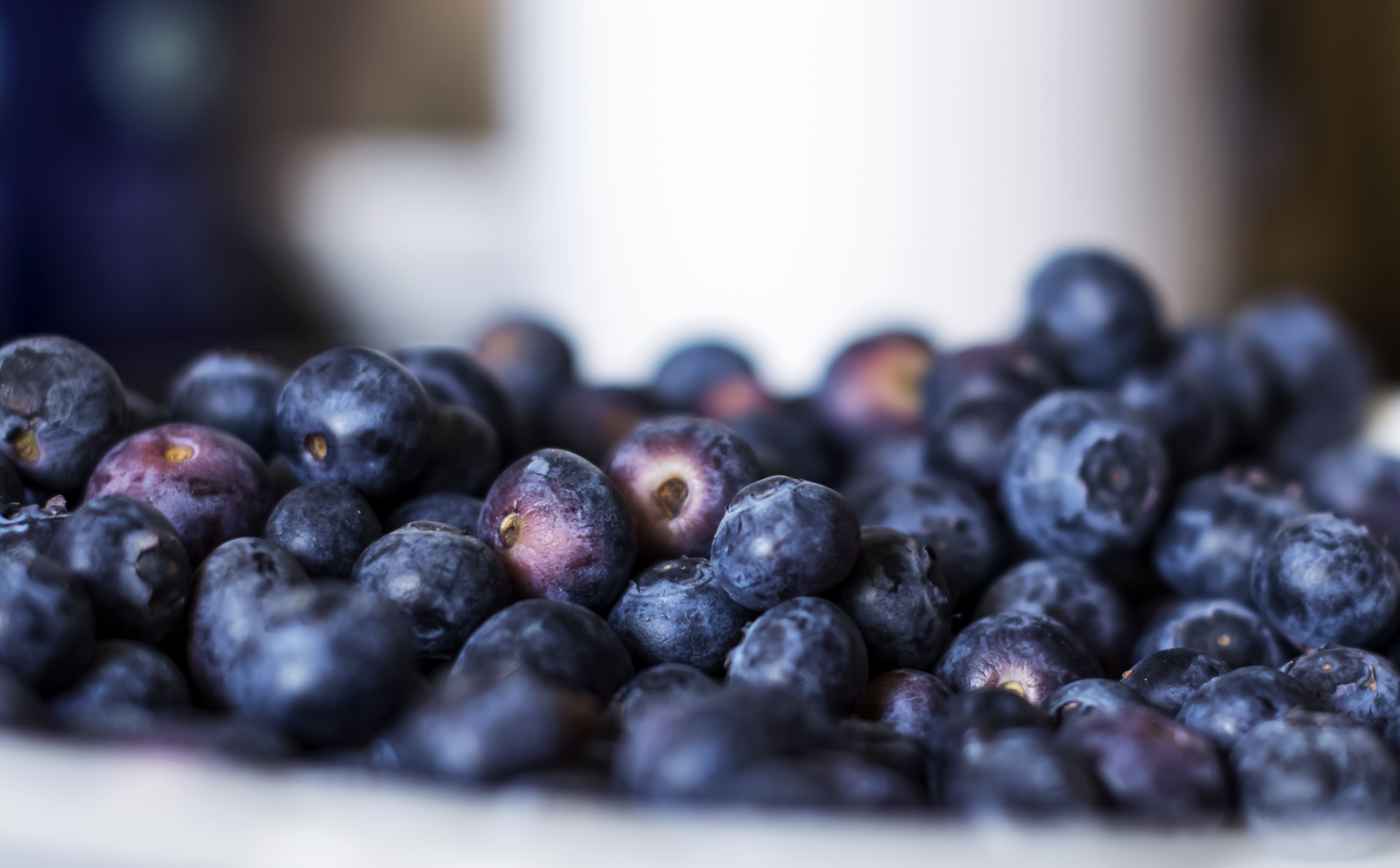 Close-up of a large amount of blueberries in a bowl