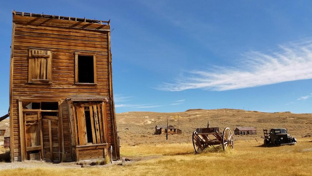 brown 2-storey house near wagon