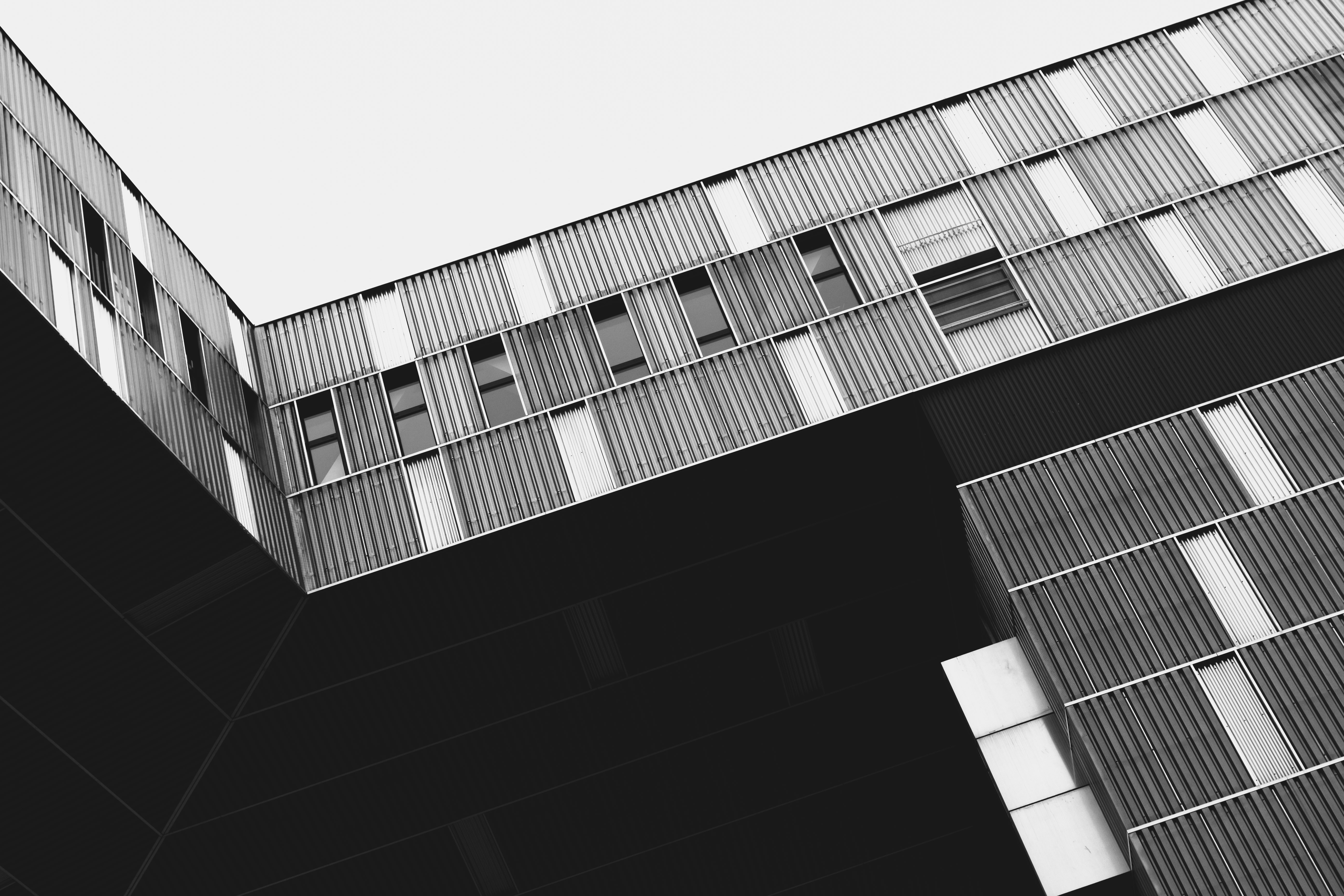 A black-and-white shot of an industrial-style building in Vienna
