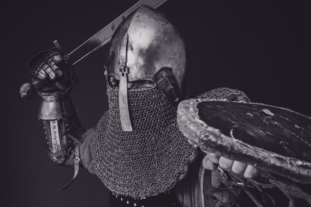 man with steel and chainmail armor holding sword