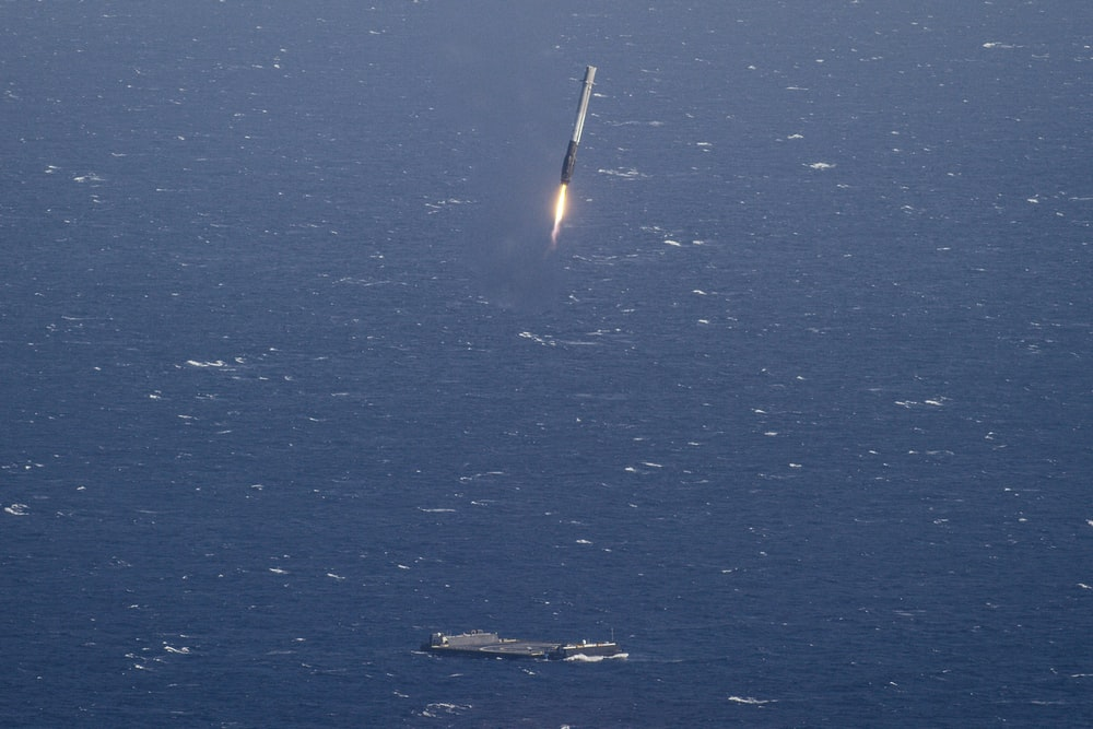 aircraft carrier and missile launching during daytime