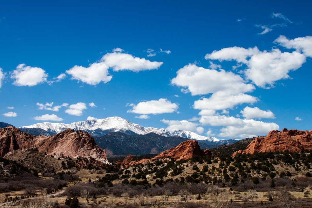Snowy mountains over red rocks