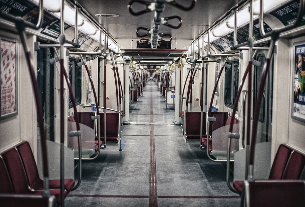 white and red train indoor view