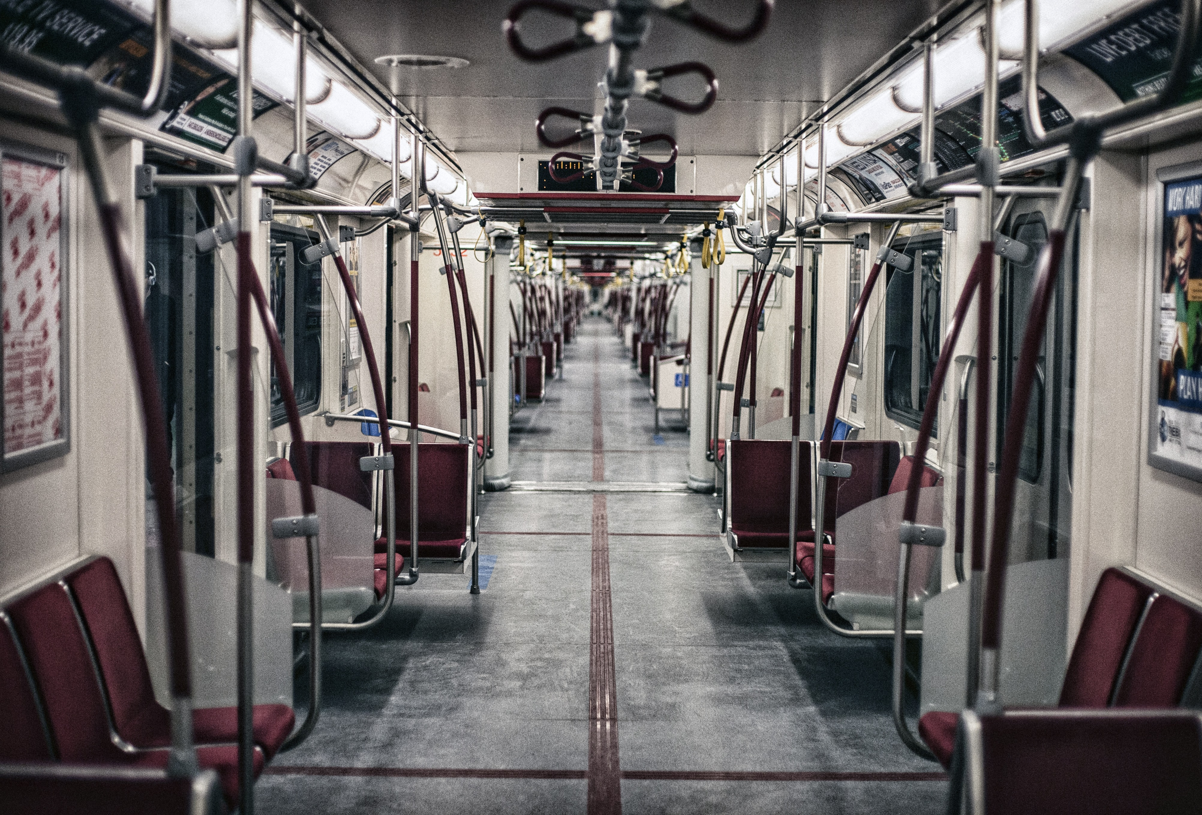 View of a long empty subway train interior in Toronto.