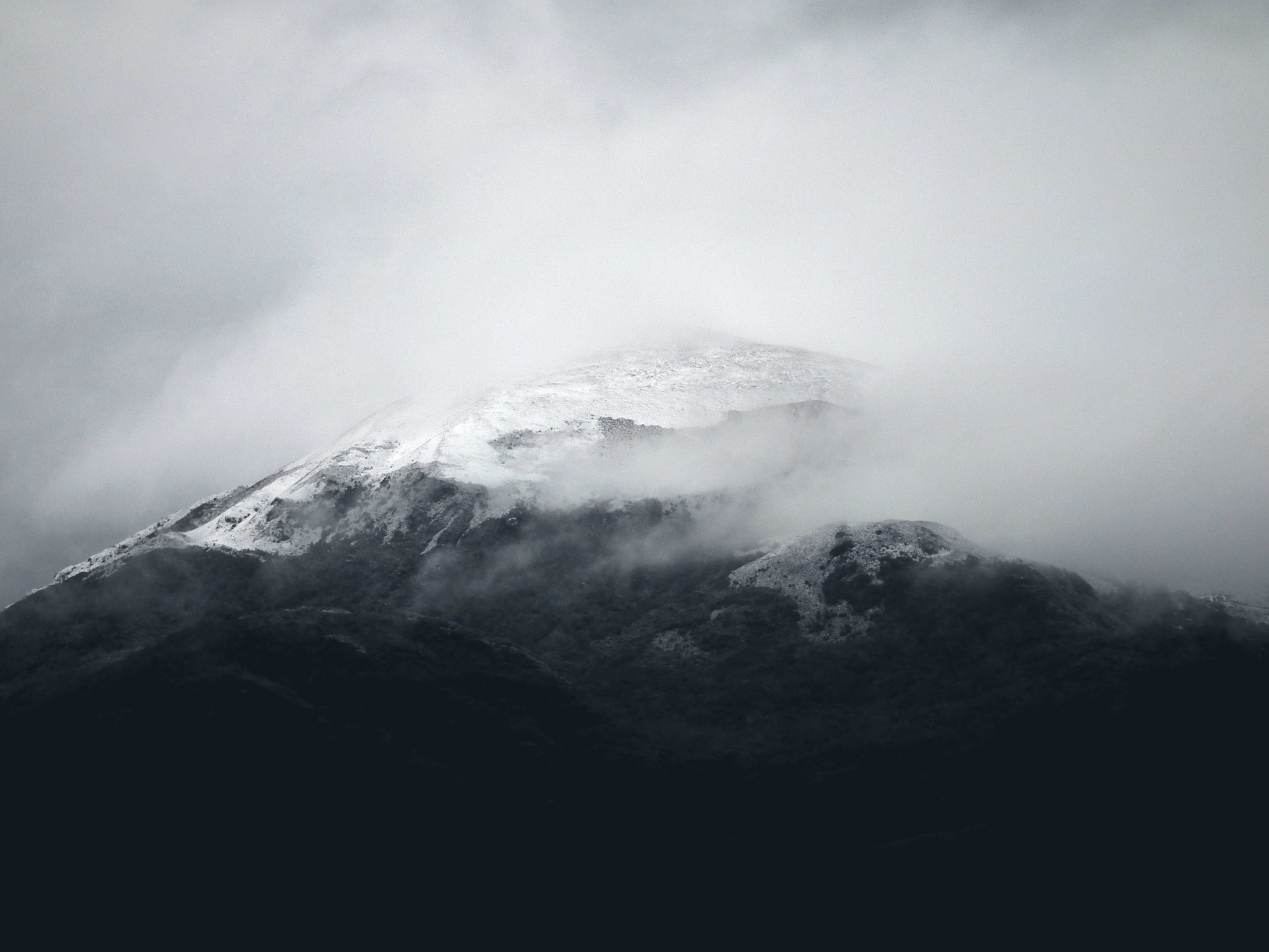 Snowy mountain peaks on a gray overcast day