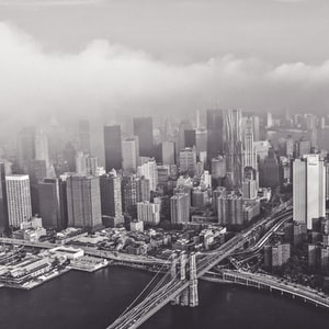 Black and white photo of fog surrounding the New York City skyline