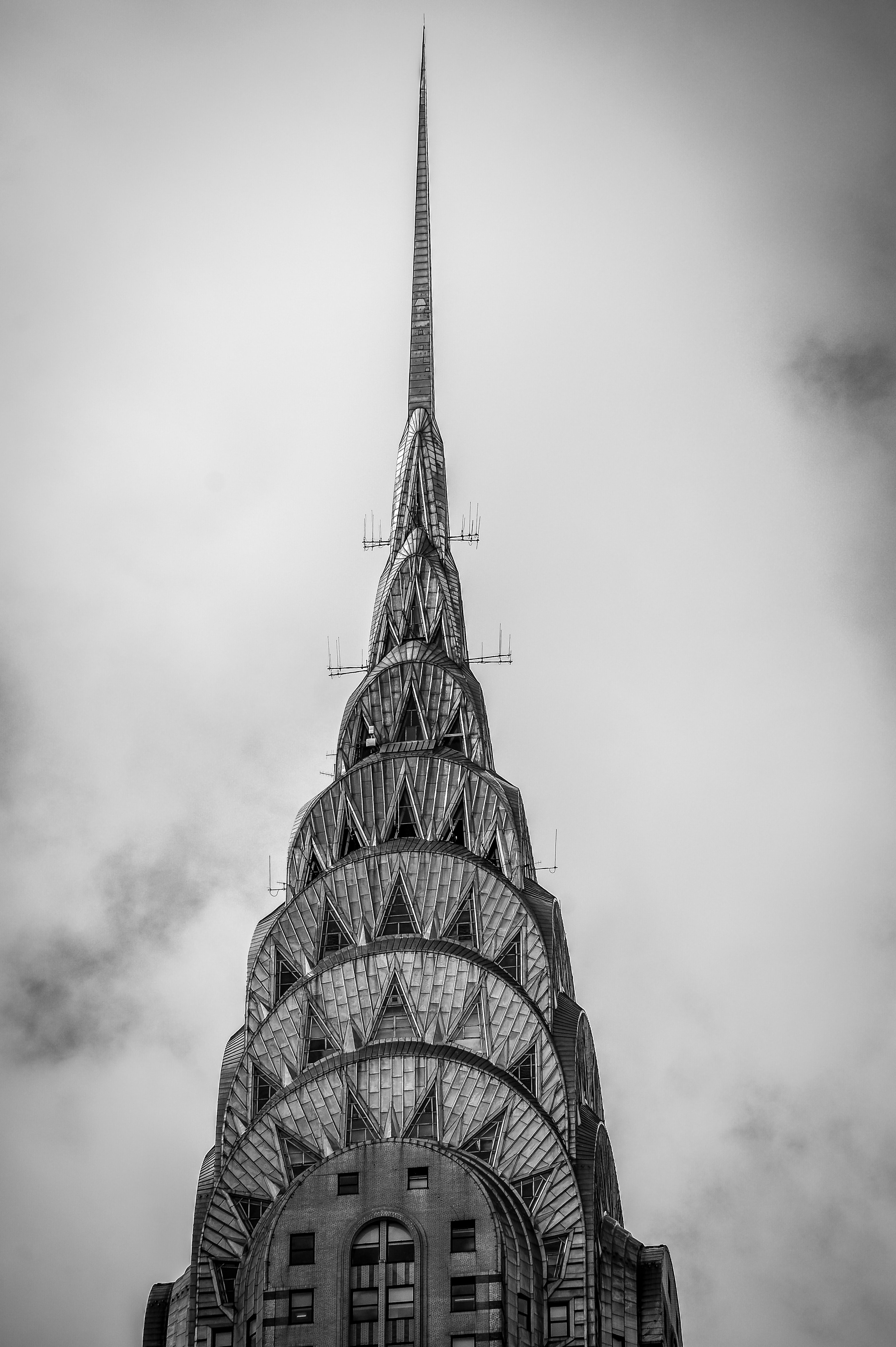 Black and white photo of the top of the Chrysler Building in New York City
