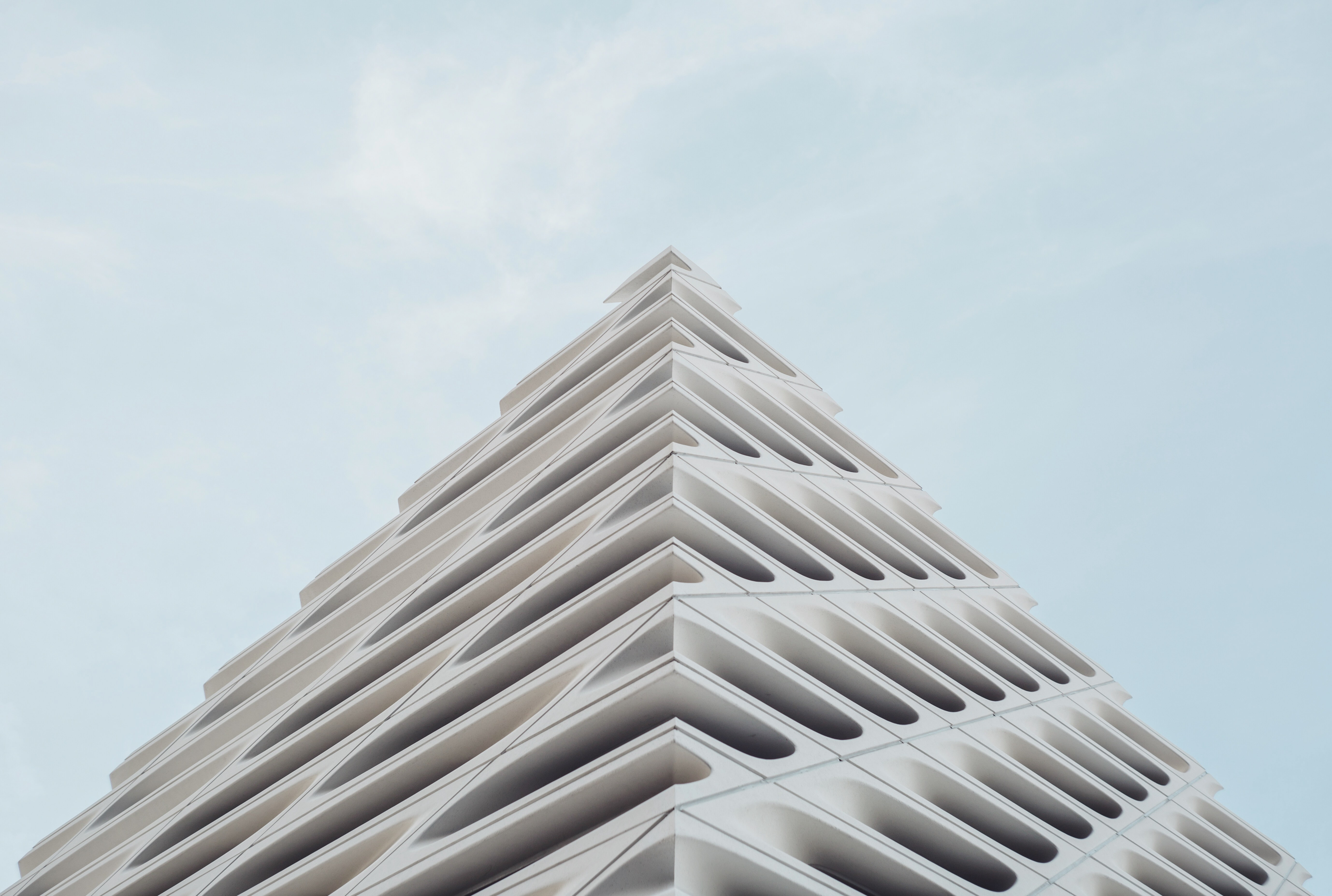 The top edge of an oddly shaped white facade