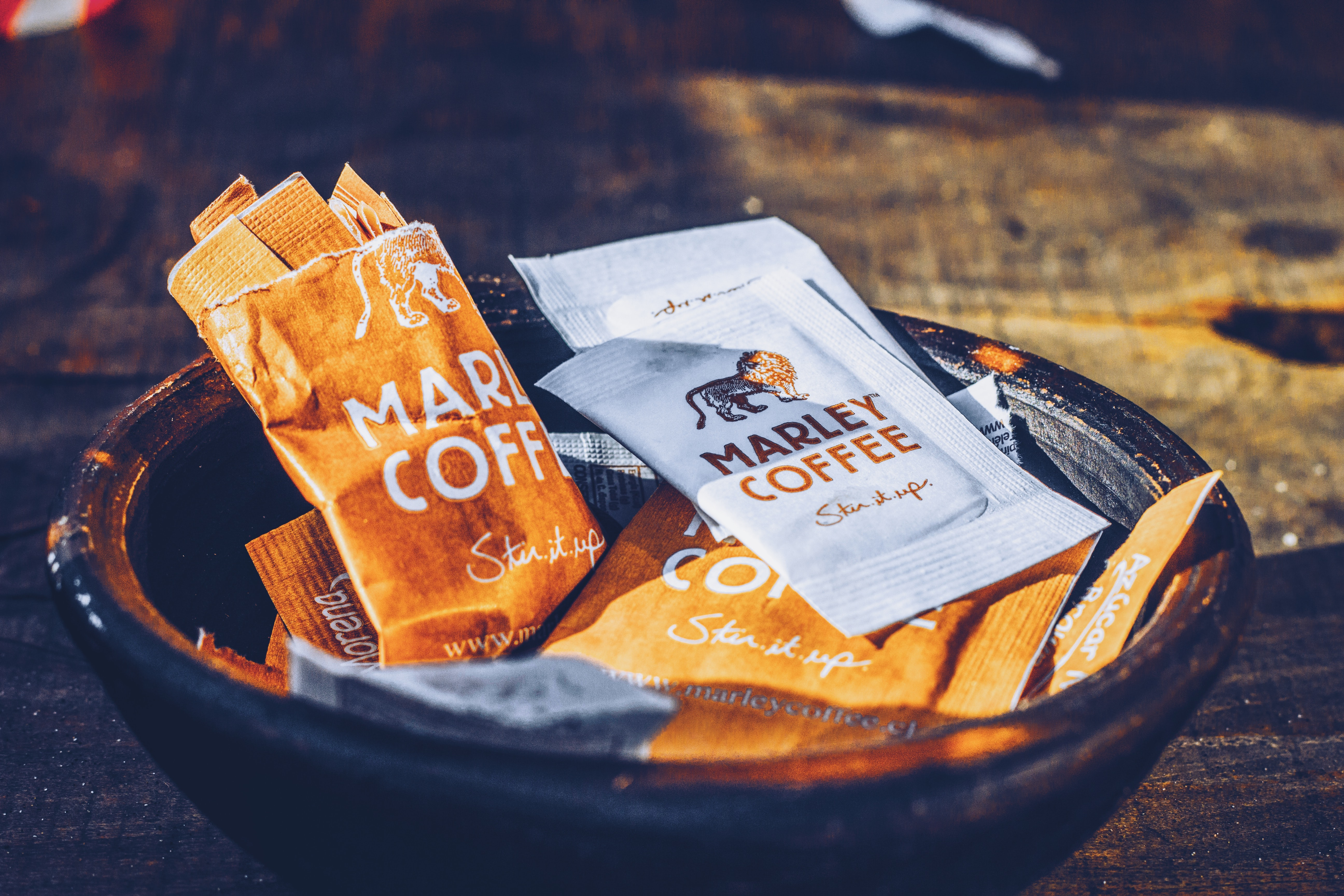 A bowl of Marley Coffee packets.
