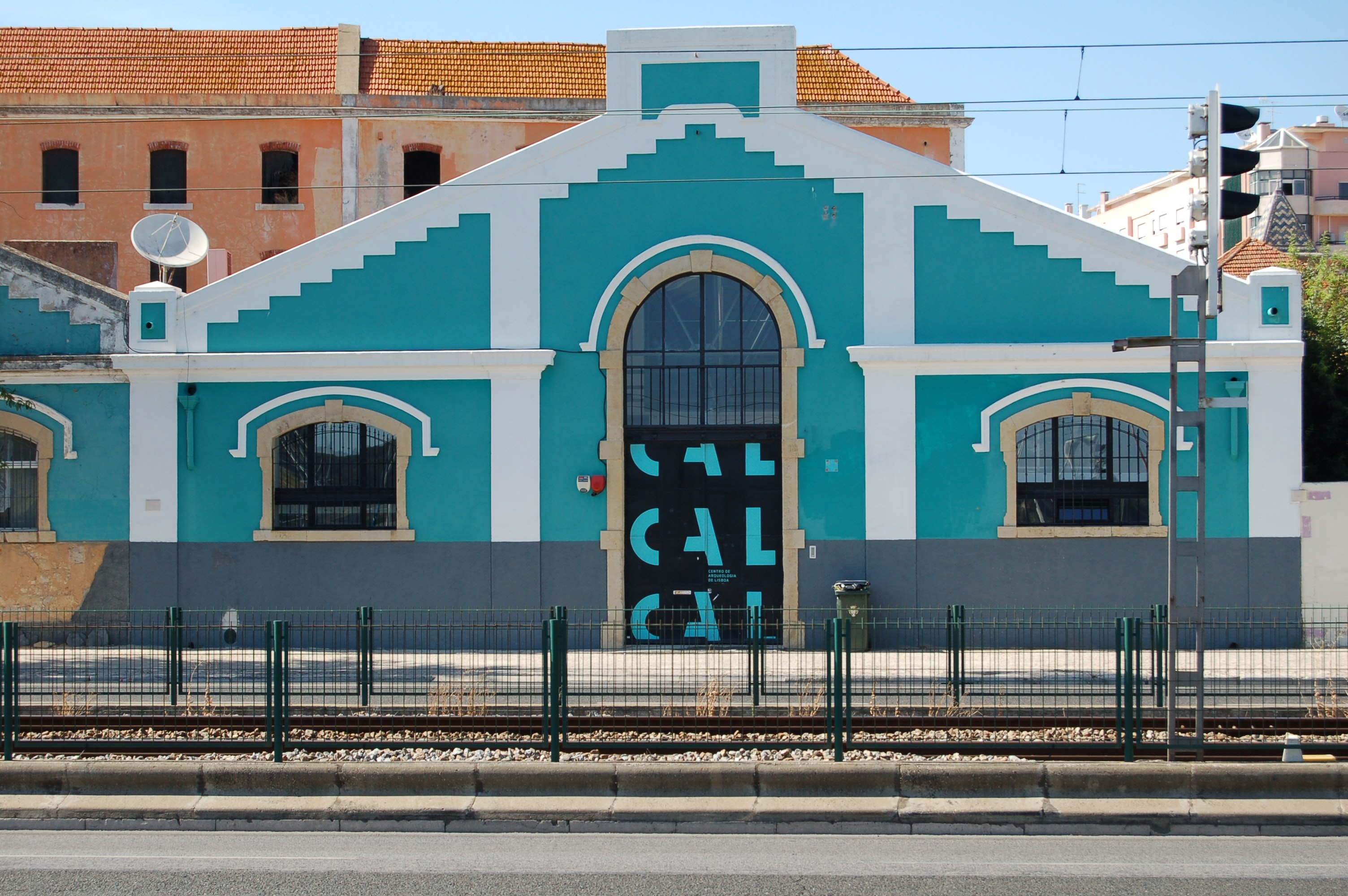 teal house near railway
