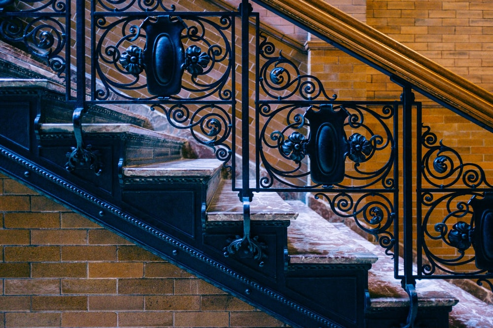 black metal railings on brown concrete staircase