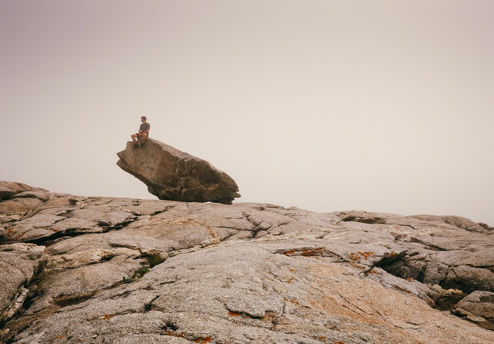 person siting on top of rock