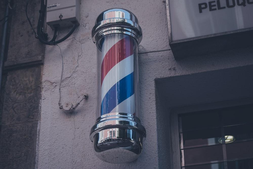 barber's poll on gray wall