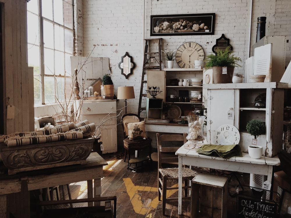 white wooden cabinet near table inside room