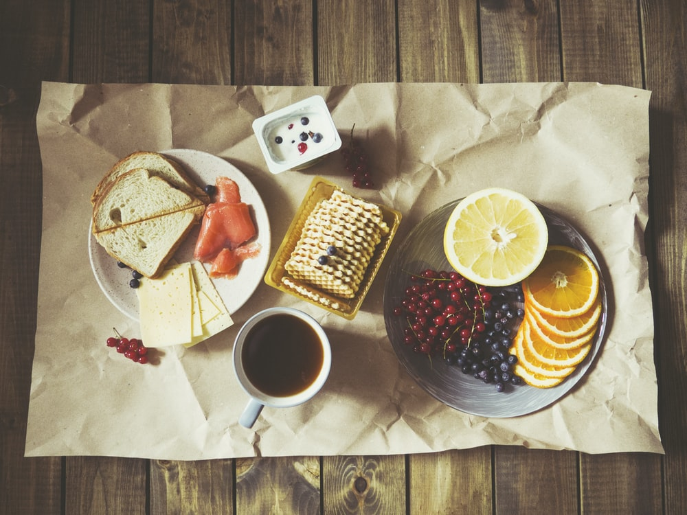 bread and fruits on plate