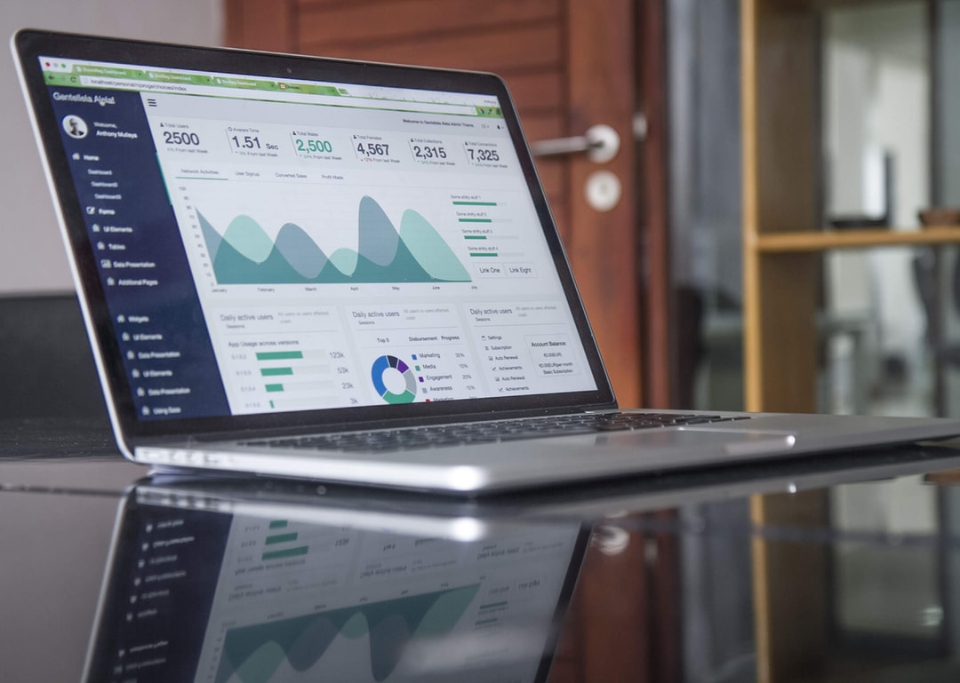 Data analytics and graph on silver laptop screen