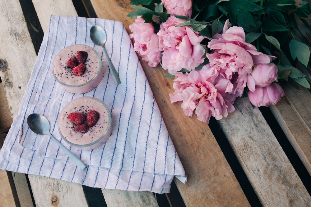 two cupcakes on brown wooden pallet