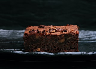 sliced baked brownies on foiled tray