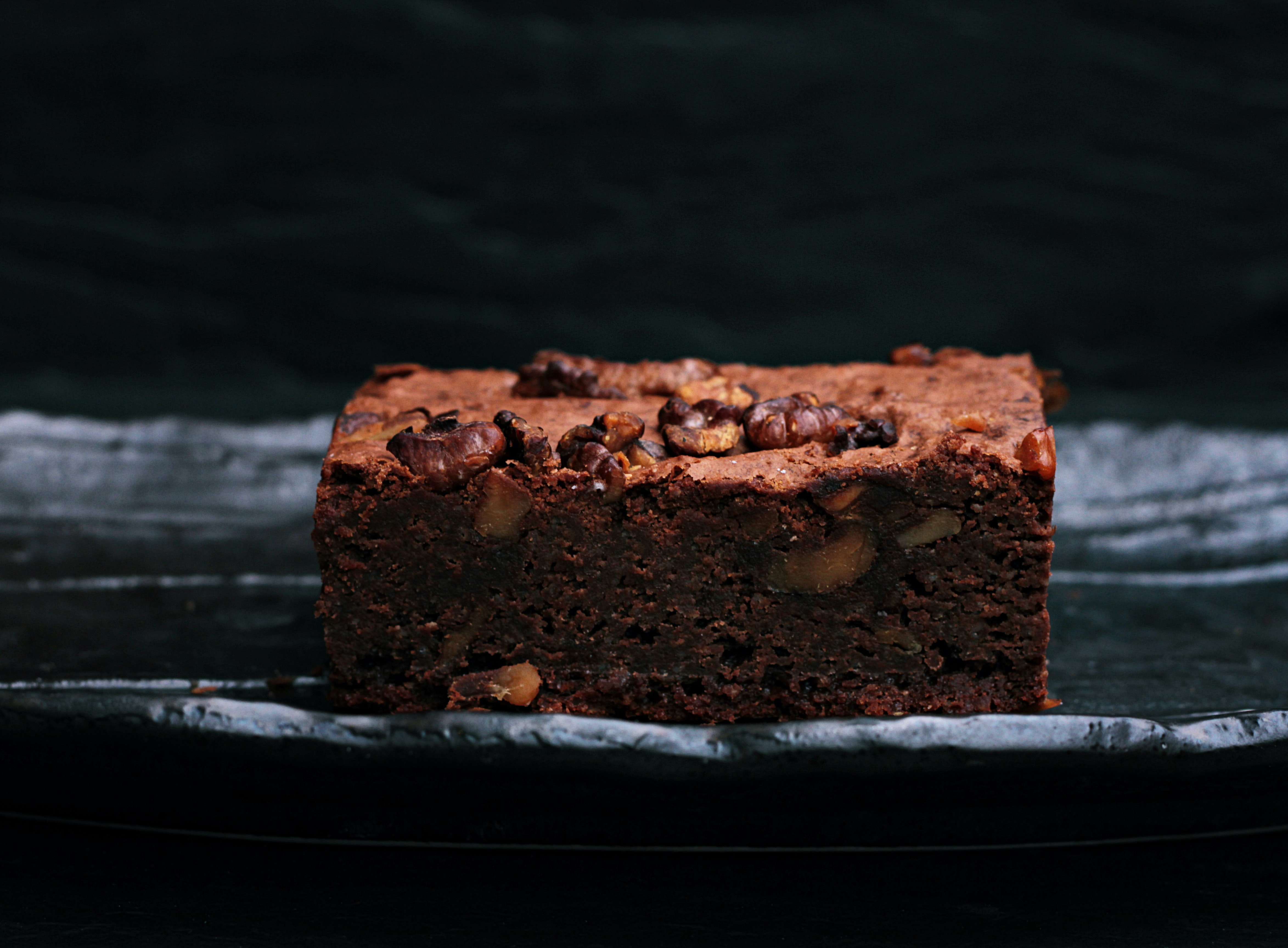 Homemade chocolate, gooey brownie with nuts