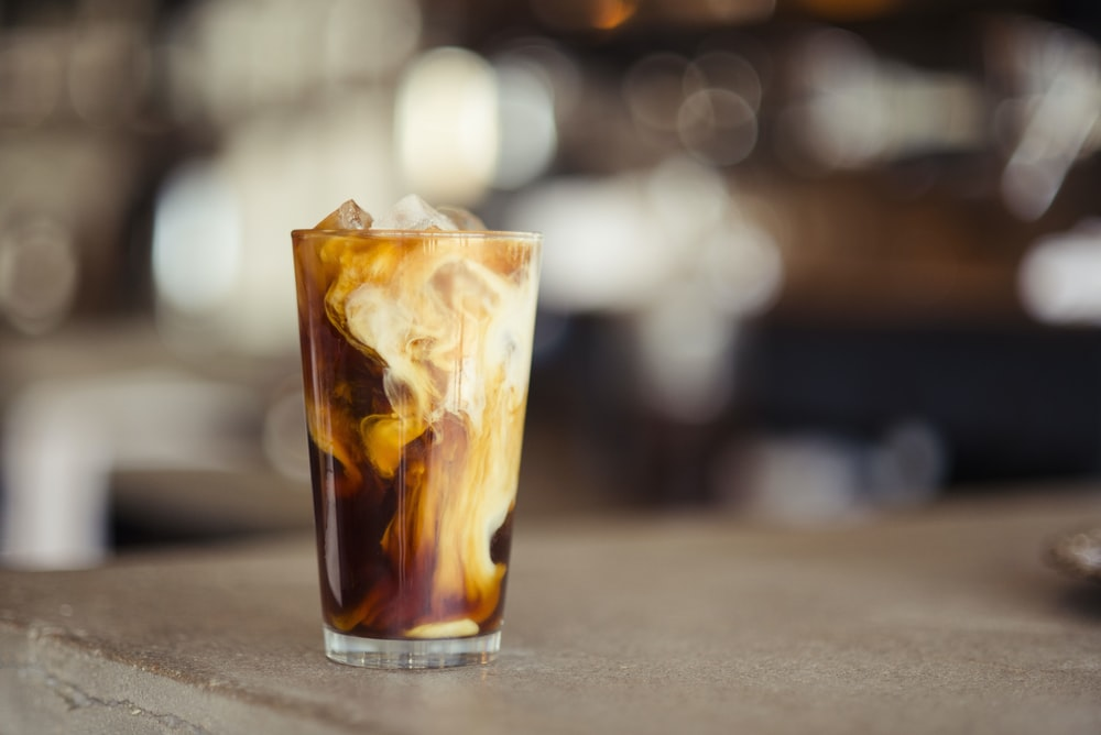 glass cup filled with ice latte on tabletop