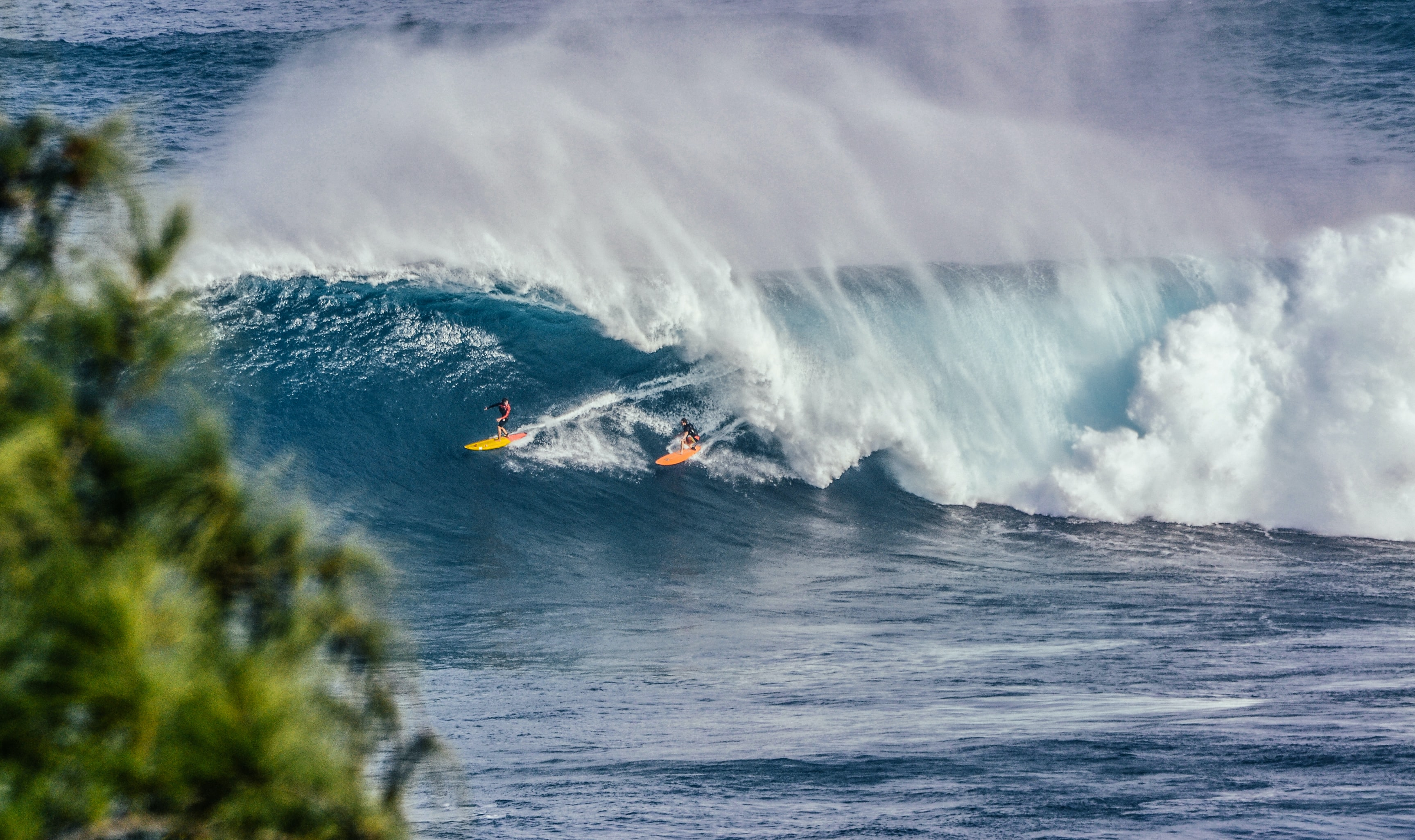 Two surfers in the water as the waves break at Jaws