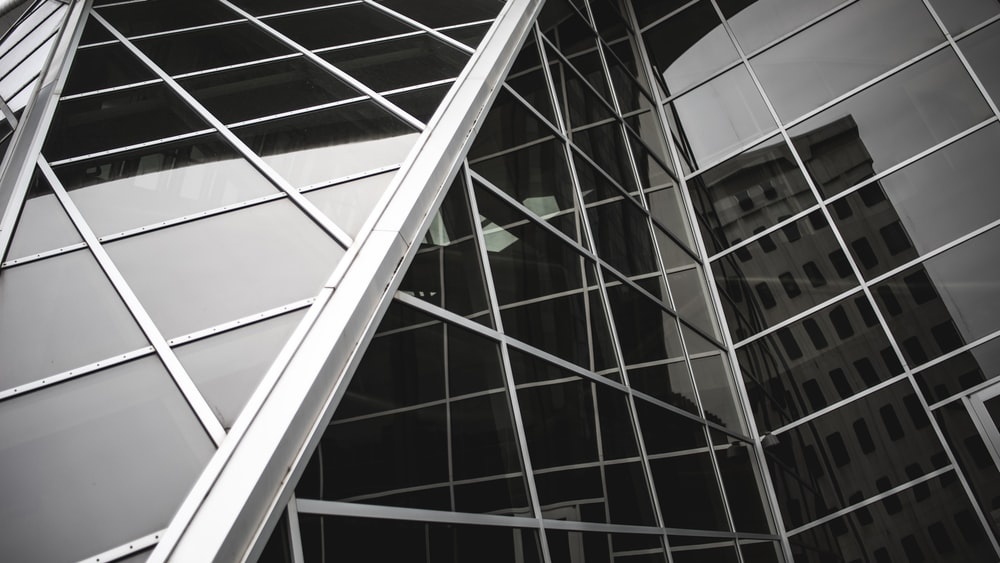 close-up photography of glass curtain building