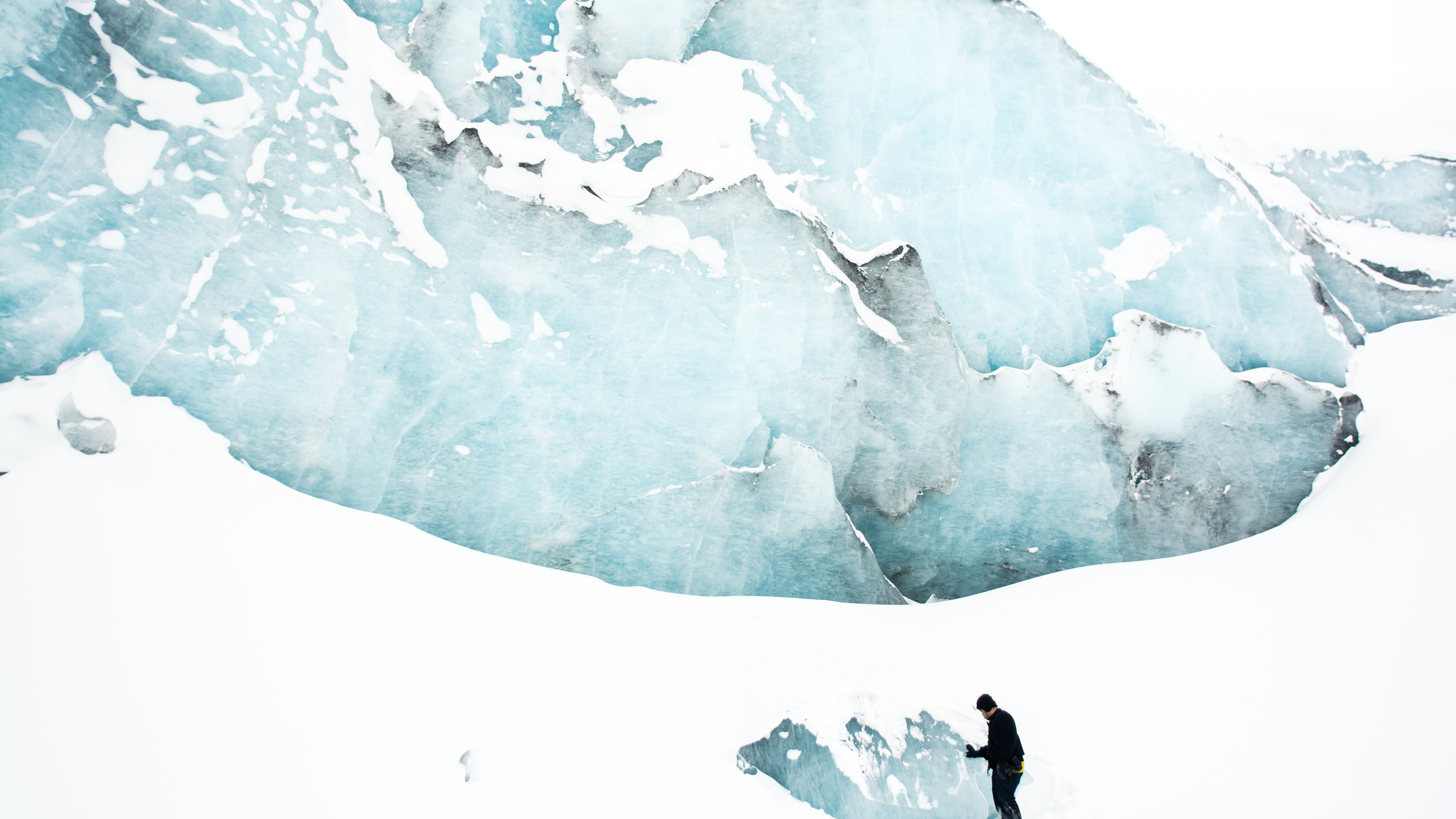person standing on snow field near mountain