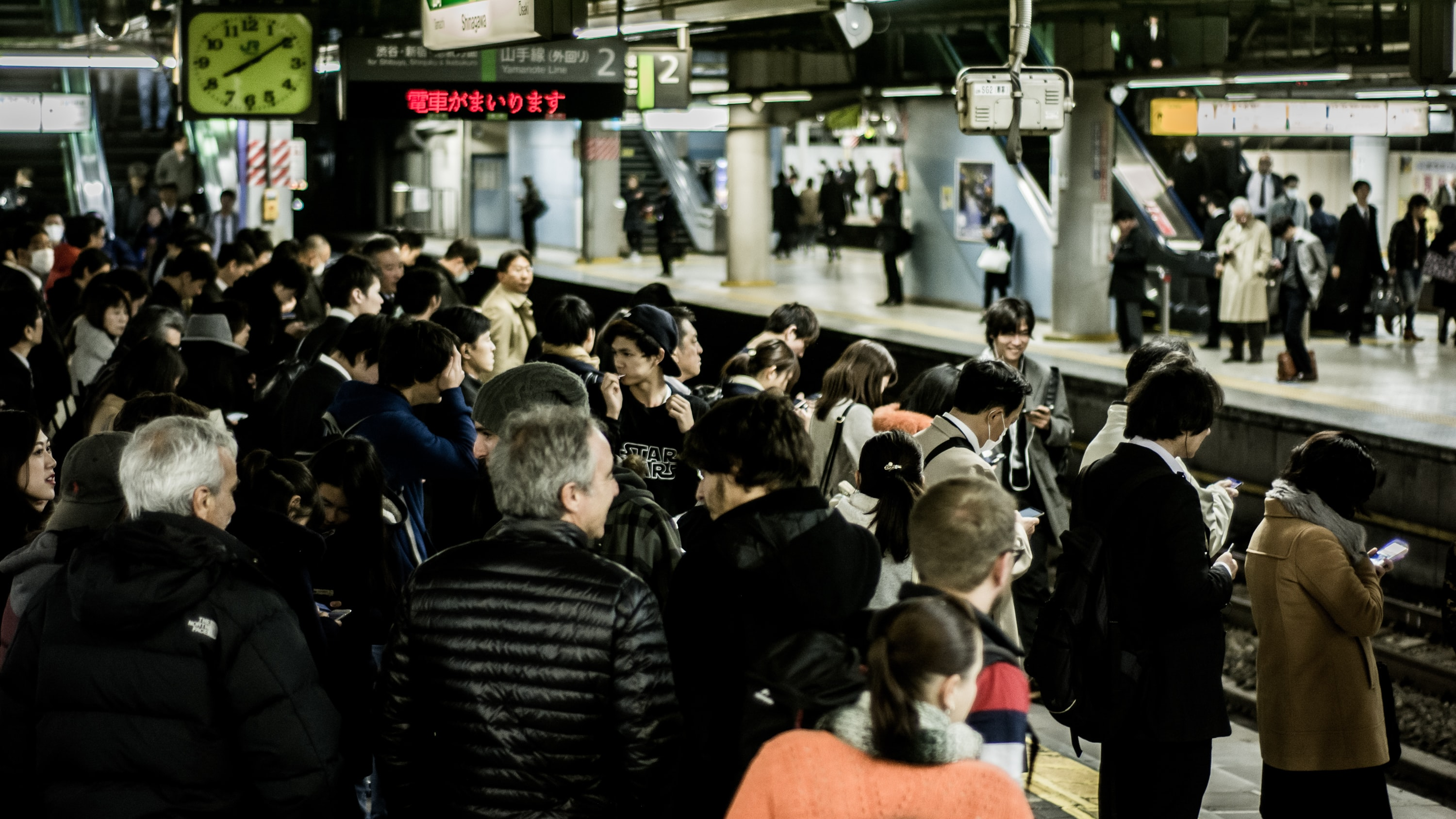 A busy train station in Tokyo's Shinjuku district