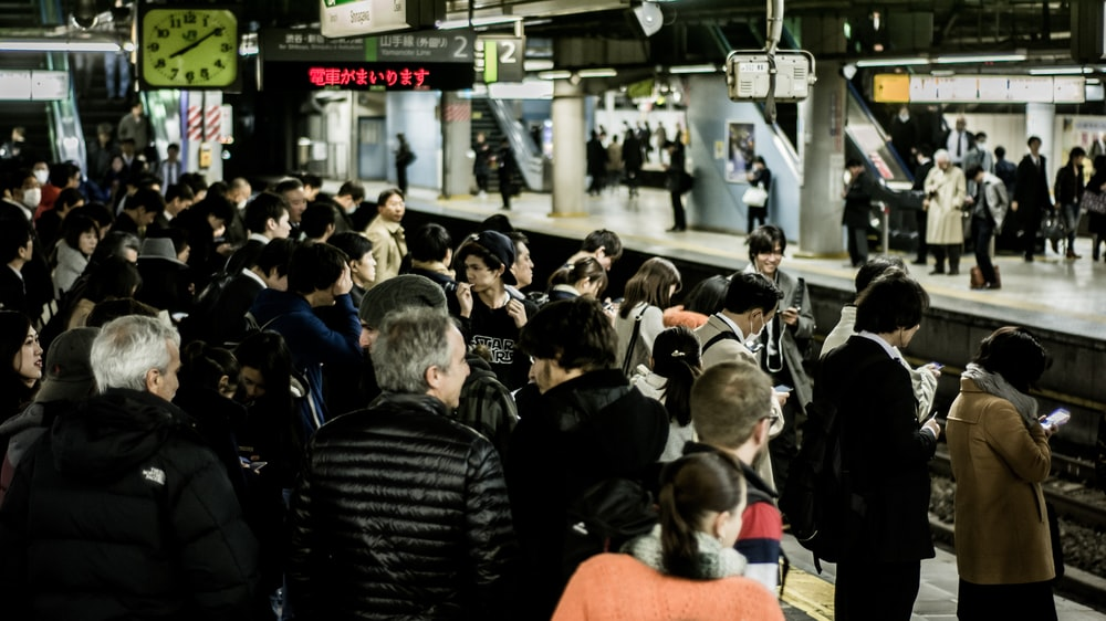 people waiting for train
