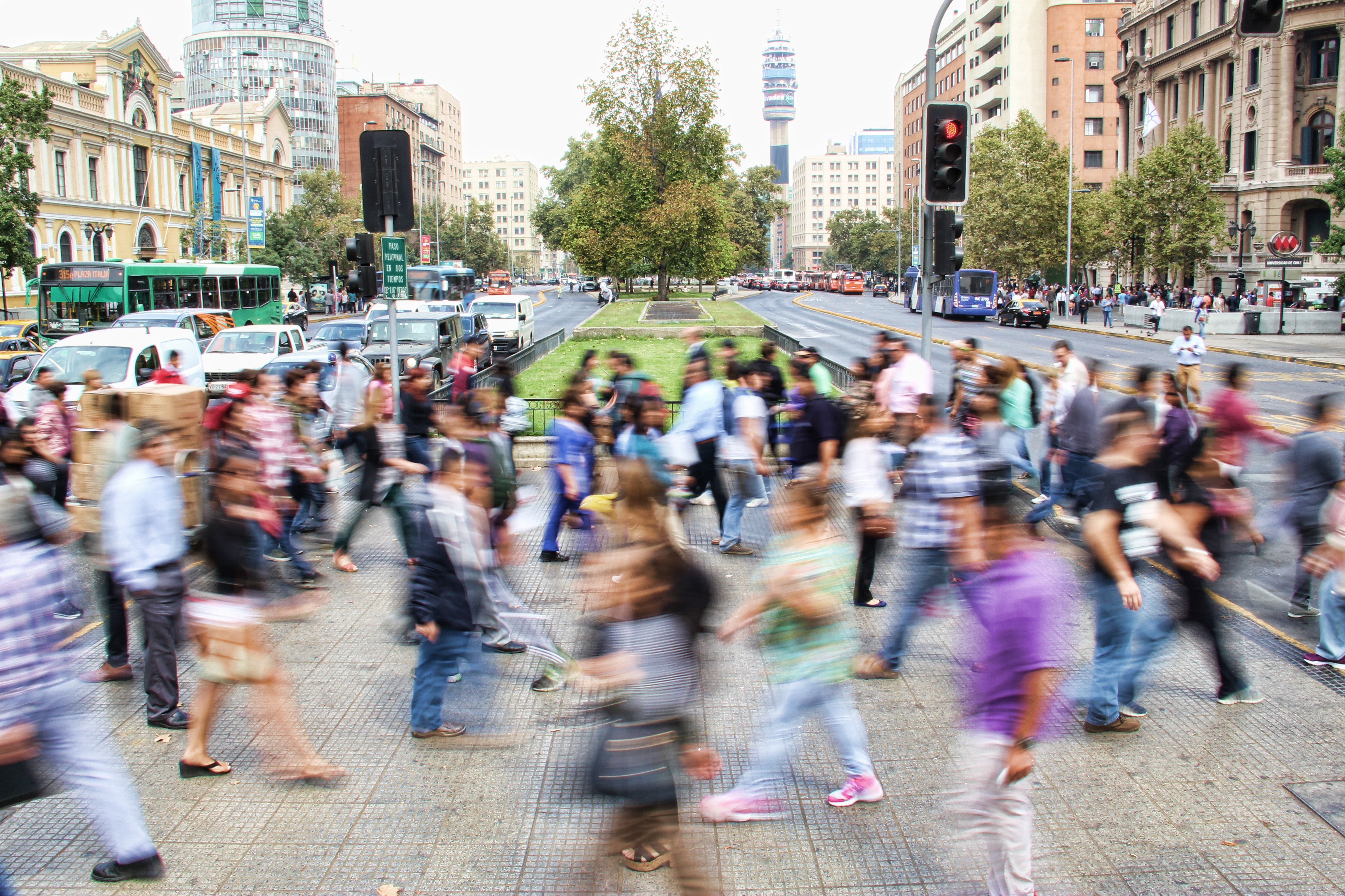 A long-exposure shot of a busy crosswalk in Santiago