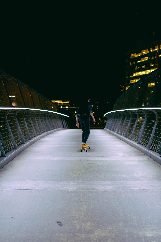 man skating on gray concrete road