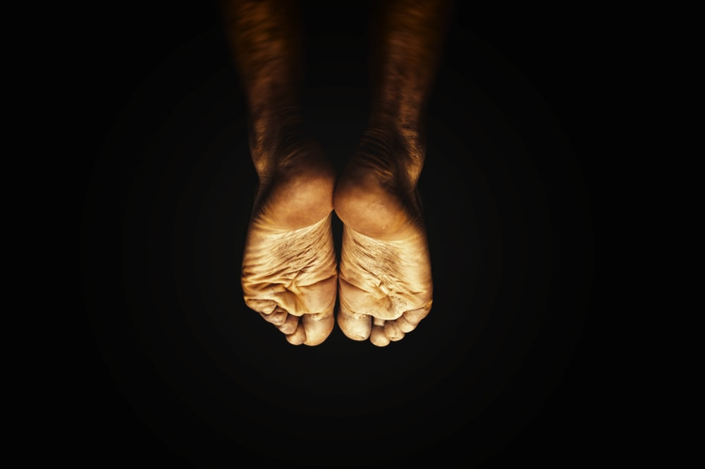 persons feet on black background