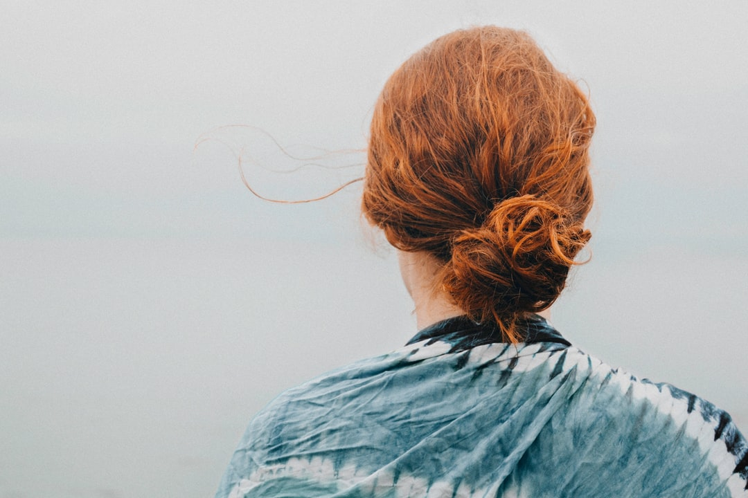 Woman red hair looking at sky