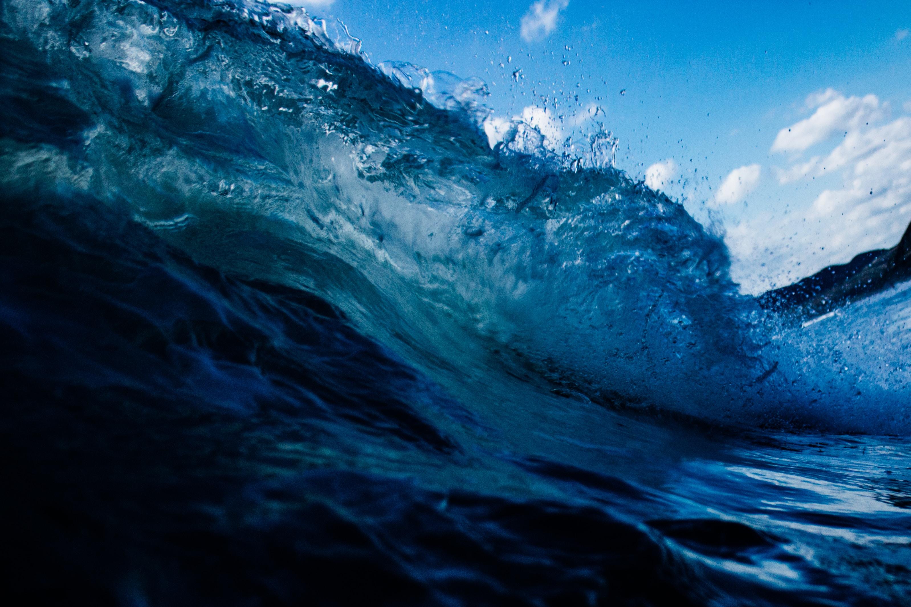 Wave splash of the blue ocean at Ngarunui Beach