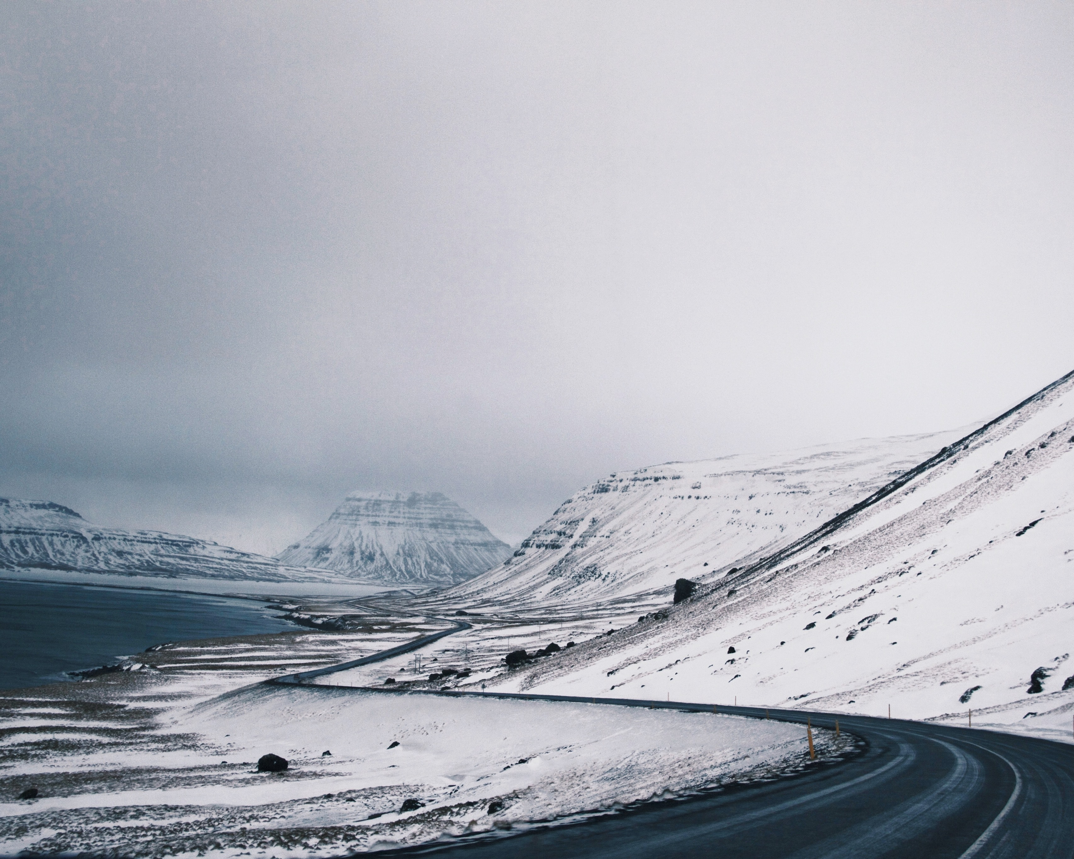 Winding winter roads through snowy mountains in Iceland