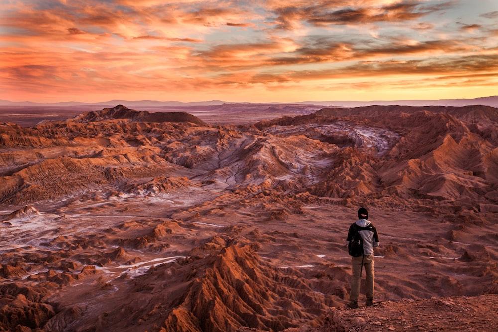 man standing near mountains